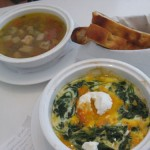 Clockwise, Onion Soup, $7; breadsticks, and Baked spinach omelet with goat cheese, $12