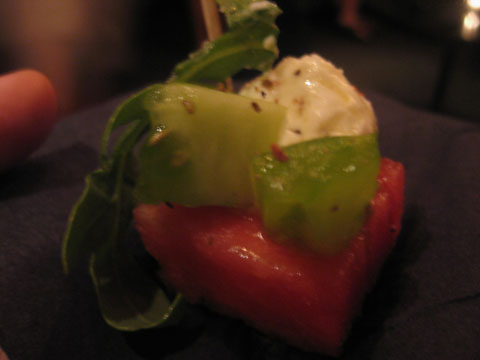 tomato watermelon salad with goat cheese,  arugala, and juniper