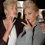Gwen Stefani and a L.A.M.B. model show off their white polish