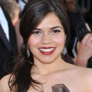 America Ferrera sports red lips, looking far from her TV counterpart