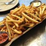 Salt and pepper frites with romesco and aoili