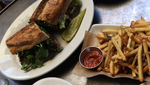 Hanger steak sandwich with roasted anaheim pepper, arugula, and horseradish aioli